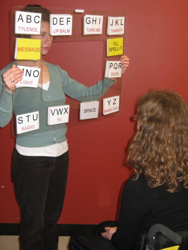 A woman holding a visual aid for a presentation