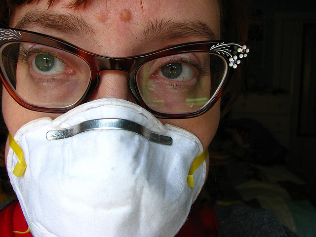 A woman wearing a mask to protect her breathing