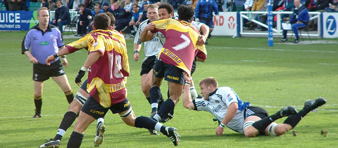 Rugby players colliding during a rugby match.