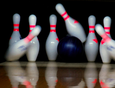 A bowling ball, just as it is striking the pins.