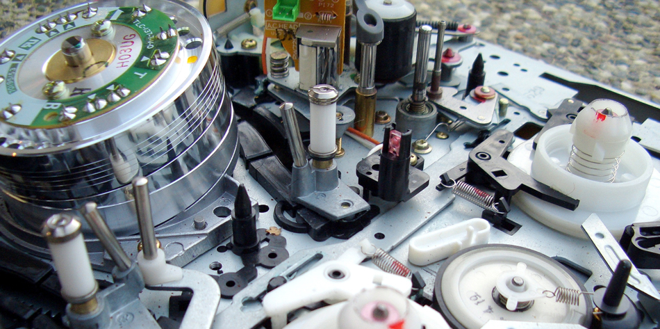 Photograph of the electronic components of playback heads used with audio and video magnetic tapes.