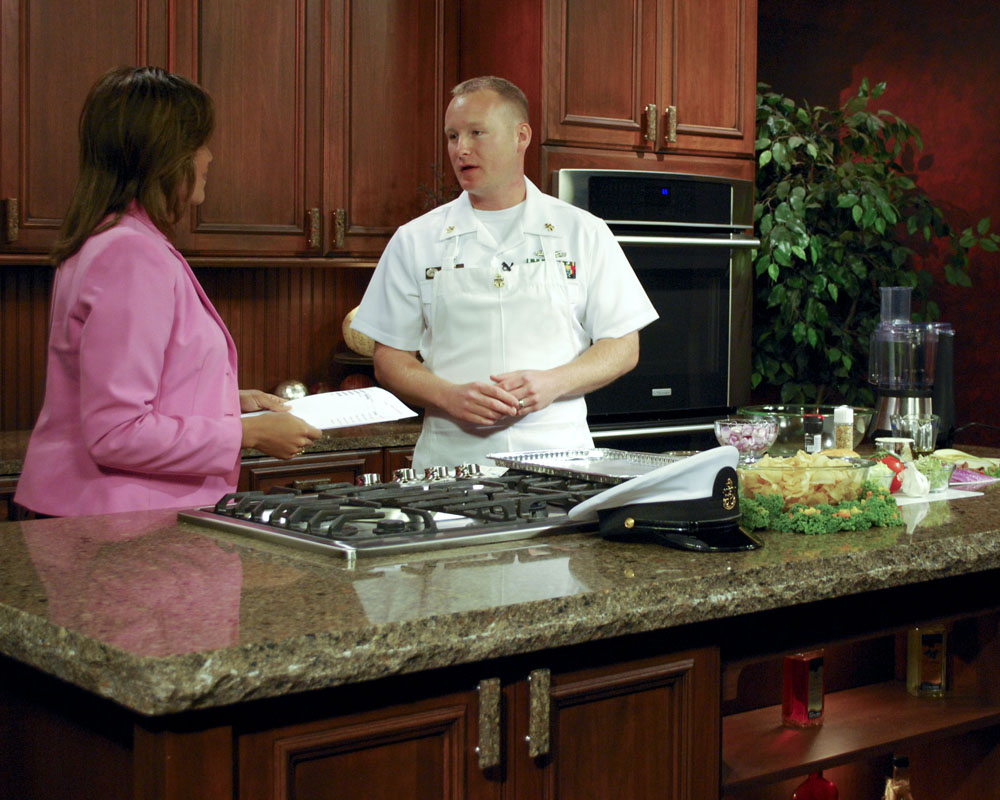 Chief Navy Counselor John Epp performs a cooking demonstration on a local TV station as part of Twin Cities Navy Week. Twin Cities Navy Week is one of 20 Navy Weeks planned across America for 2010. Navy Weeks show Americans the investment they have made in their Navy and increase awareness in cities that do not have a significant Navy presence. (U.S. Navy photo by Mass Communication Specialist 3rd Class Sean Gallagher/Released)