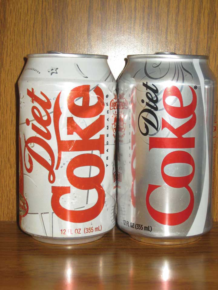 An old Diet Coke can next to a new one