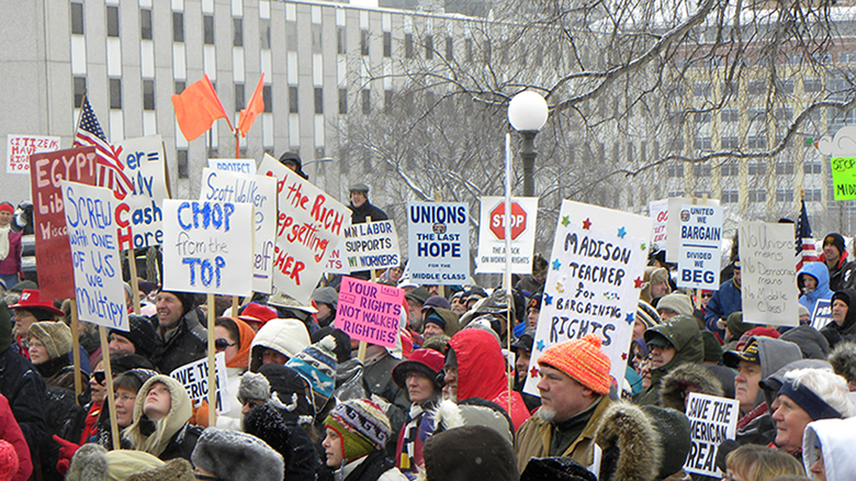 This photograph shows people protesting in response to Wisconsin governor Scott Walker's collective bargaining laws.