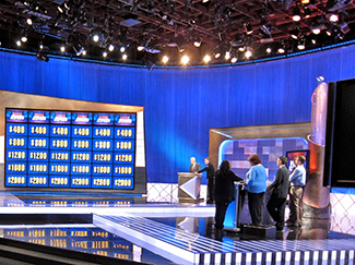 A photograph shows the game show Jeopardy.