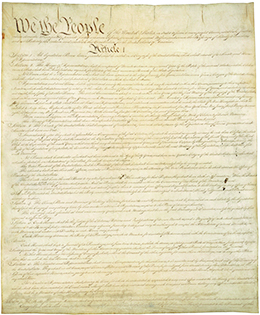The first page of the U.S. Constitution is shown.