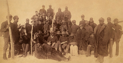 "A photograph shows a posed group of uniformed ""Buffalo Soldiers."""
