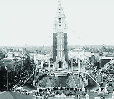 A photograph shows the Dreamland Amusement Park tower at Coney Island.