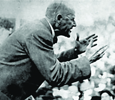 A photograph shows a close-up of Eugene Debs speaking and gesturing energetically to a crowd.