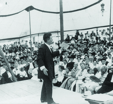 A photograph shows Robert La Follette speaking animatedly to a large crowd.
