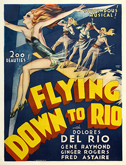 "A movie poster for Flying Down to Rio shows drawings of four young women in short dresses, with their arms spread out in various poses. The text reads, ""Stupendous musical! 200 Beauties! Flying Down to Rio with Dolores del Rio, Gene Raymond, Ginger Rogers, Fred Astaire."""