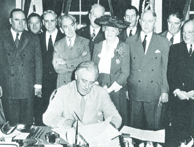 A photograph shows Franklin D. Roosevelt seated at a desk signing the GI Bill, surrounded by members of Congress.