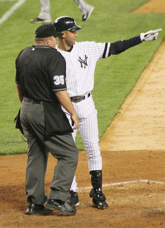 New York Yankees shortstop Derek Jeter talks with the home plate umpire after his inning-ending strikeout during the Yankees game against the Arizona Diamondbacks on June 12th at Yankee Stadium.